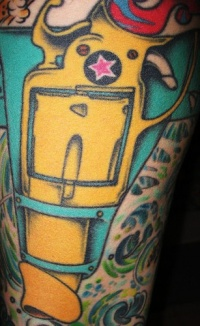 Leg tattoo, yellow packed gun covered, designed with star