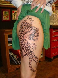Tattoo on leg, angry, teethy black and white tiger