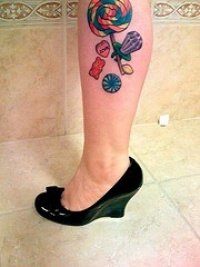 Leg tattoo, parti-coloured candies, bear, heart, for child
